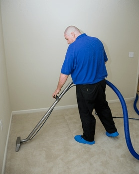 Man Cleaning Carpet in Ellicott City